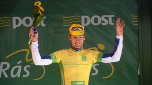 Marcin Bialoblocki salutes the crowd in Naas as he retains the yellow jersey.