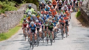 The peleton makes its way over a bridge in Glenmalure, Co. Wicklow.