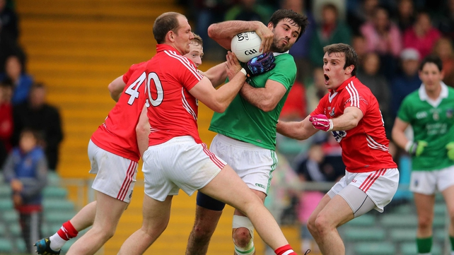 Limerick's John Galvin comes under intense pressure from the Cork duo of Alan O'Connor and James Loughrey
