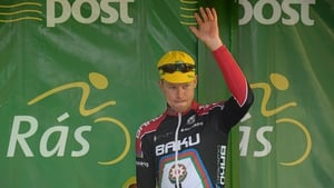 Connor McConvey, second overall on GC, salutes the crowd.