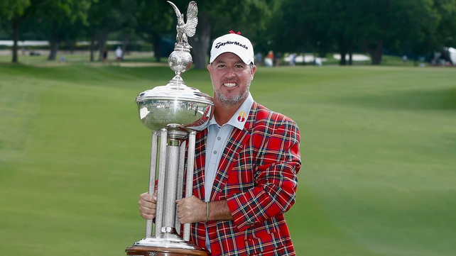 Boo Weekley with the trophy after his one-stroke victory at the Crowne Plaza Invitational