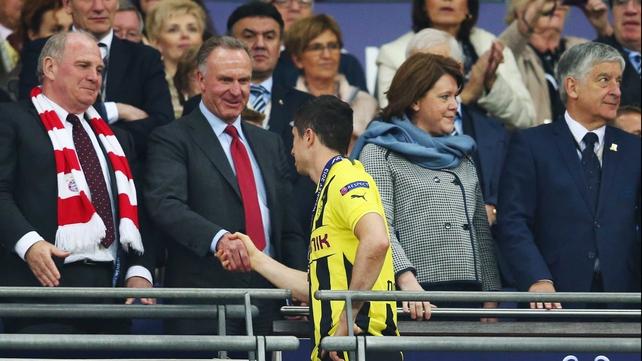 Robert Lewandowski receives commiserations from Bayern Munich officials