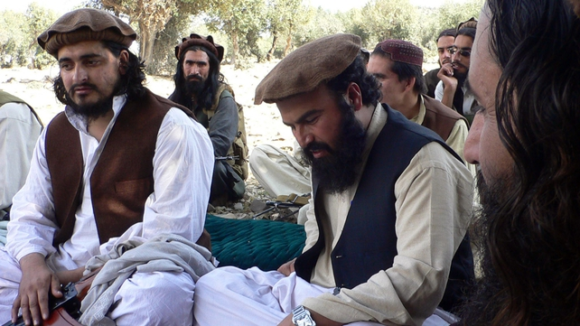 Photograph taken in 2009 shows new Pakistani Taliban chief Hakimullah Mehsud (L) sitting with his commander Wali-ur Rehman