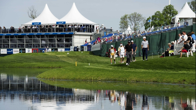Miguel Angel Jimenez (c), Matteo Manassero (r) and Peter Hanson (second-r) walk to the 17th green