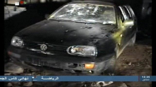 Syria's state-run television showed pictures of a damaged car with broken windows