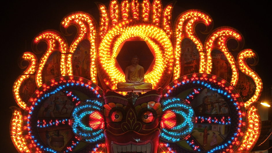 A view of a giant Vesak day display featuring a seated Buddha during the annual Vesak Buddhist festival in Colombo