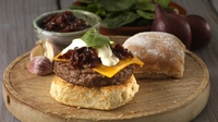 "Superburger with red onion marmalade, cheddar and sour cream - Paul Flynn provides this summer BBQ recipe, using Lidl Ireland products! ""I love having these with rosemary fries,"" Paul adds."