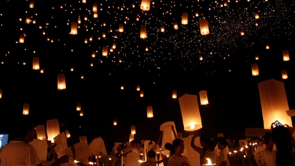 Students release 15,185 sky lanterns during an attempt for the Guinness Book of World Records for biggest number of sky lanterns flown simultaneously, on the football field of the University of the Philippines, Visayas