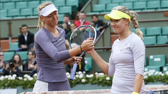 Maria Sharapova (L) shakes hands with Canada's Eugenie Bouchard afterwards