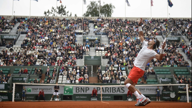 Rafael Nadal serves against Martin Klizan today
