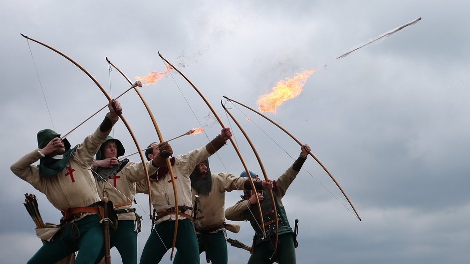 Purbrook Bowmen fire a volley of flaming arrows from Southsea Castle as part of a day of events to mark the opening of the Mary Rose Museum in Portsmouth