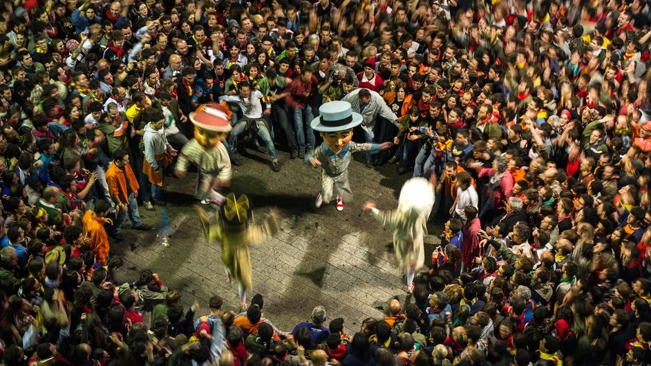 Revellers surround the Nans Vells (old dwarves) as they dance during the first day of La Patum Festival in Berga, Spain