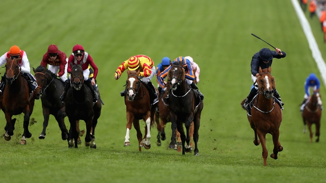 2013 Epsom Derby winner Ruler Of The World (second right). Favourite Dawn Approach (right) trails home