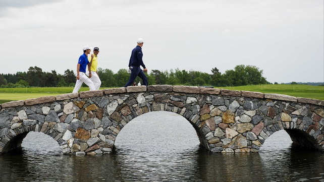 Italy's Matteo Manassero (l) and and Finland's Mikko Ilonen (r) walk to the third hole