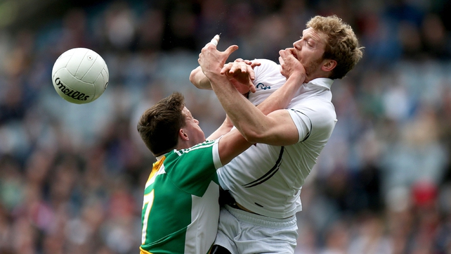 Michael Brazil of Offaly keeps a close watch on Tomas O'Connor of Kildare