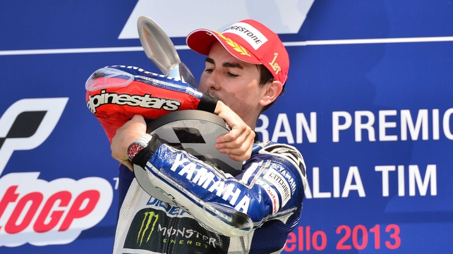 Jorge Lorenzo celebrates on the podium