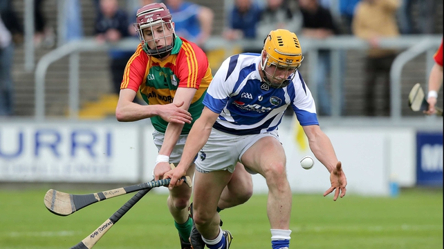 Laois' Brian Dunne vies for posession with with Alan Corcoran