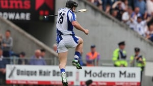 Jake Dillon jumps for joy after scoring Waterford's goal after eight minutes
