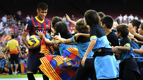 Neymar is mobbed at his unveiling at Barcelona's Camp Nou Stadium
