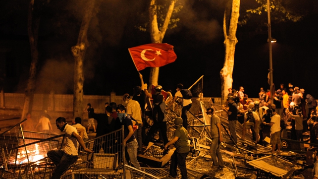 Protesters earlier clashed with riot police between Taksim and Besiktas in Istanbul