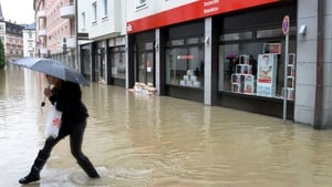 A woman makes her way through an overflooded street in Passau, southern Germany