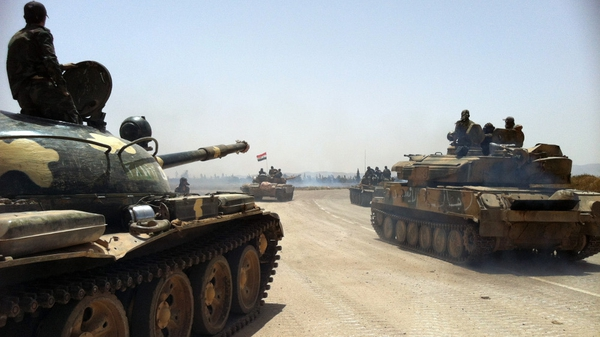 Syrian army tanks make their way to the Dabaa military airfield, north of  Qusair