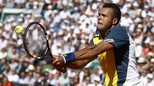 A focused Jo-Wilfried Tsonga unleashes a powerful backhand on Court Philippe Chatrier