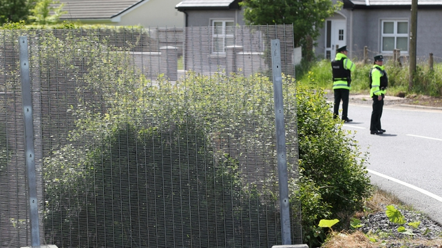 PSNI officers patrol part of the security fence around the summit venue