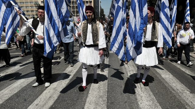 Municipal workers in Athens march towards the Greek Parliament protesting against cuts
