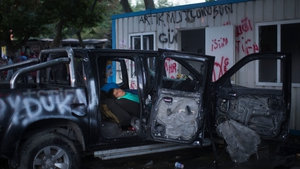 A protestor sleeps in a damaged car at the Gezi Park in Taksim Square in Istanbul