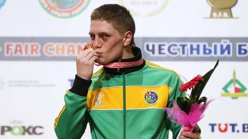 Jason Quigley kisses his gold medal