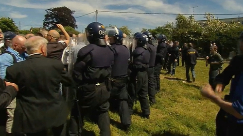 A number of gardaí in riot gear were present for the funeral