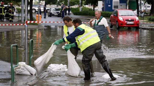 Workers line streets with sandbags in Budapest