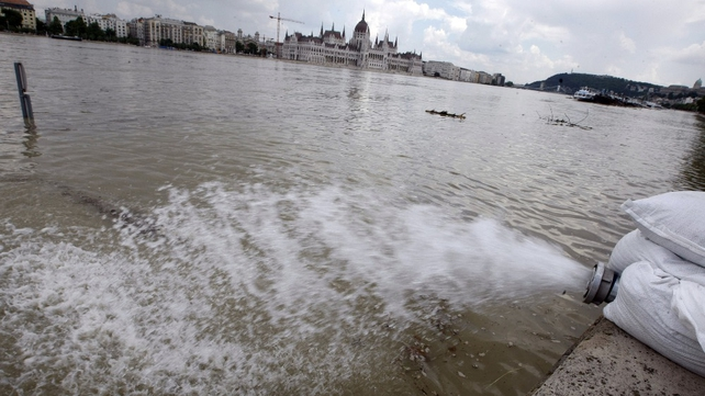 A pump drives back the water from the bank of flooded river Danube in  Budapest