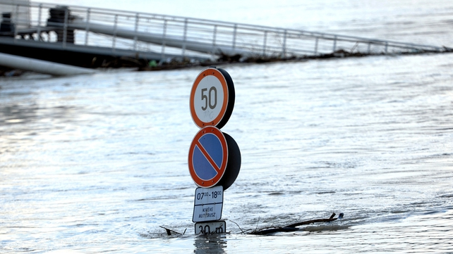 A traffic sign stands in the flood waters of the Danube at the Buda embankment