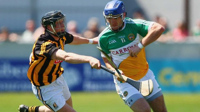 Offaly's Brian Carroll is tackled by Kilkenny's Aidan Fogarty