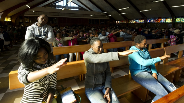 Members of a Soweto church which was a flashpoint during the anti-apartheid struggle, pray for Nelson Mandela