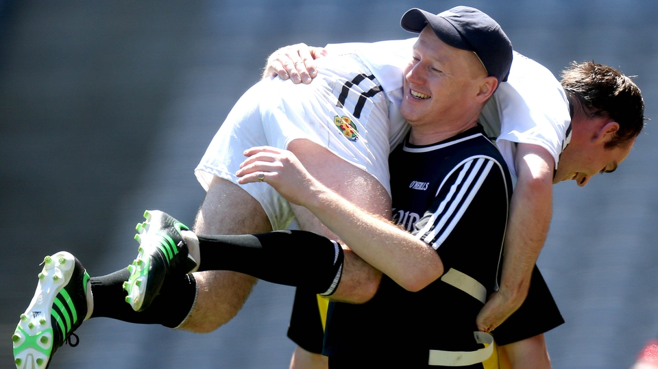 Warwickshire manager Stephen Ahern and Alan Morrissey celebrate after winning the Lory Meagher final against Longford