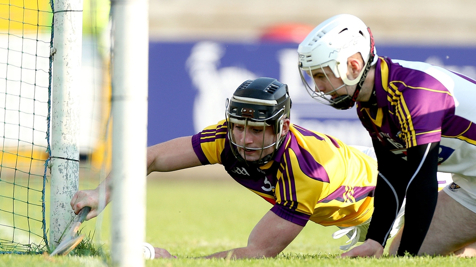 Wexford's Eoin Moore and goalkeeper Mark Fanning stop the ball on the line to prevent a goal