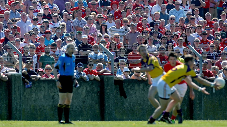 A sun-drenched crowd looks on as Wexford go on the offensive; the Model men won by a point