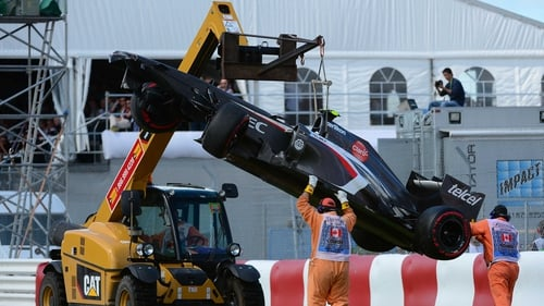 A crane lifts Esteban Gutierrezs' Sauber car at the end of the Canadian Formula One Grand Prix