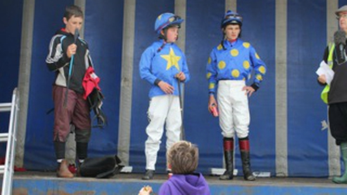 Young jockeys wait for weigh-in