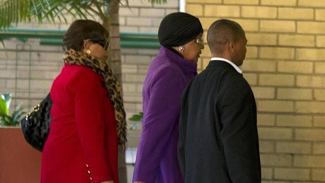 Winnie Madikizela-Mandela enters the hospital with her daughter Zindzi