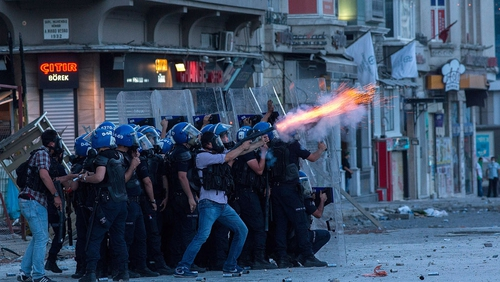 Turkish riot police fire tear gas at protesters in Taksim Square
