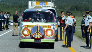Canadian police allow a protester's van through a checkpoint near Toronto in 2002