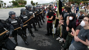 Police in riot gear keep protesters at bay in Brunswick, Georgia during the G8 summit at nearby Sea Island in 2004