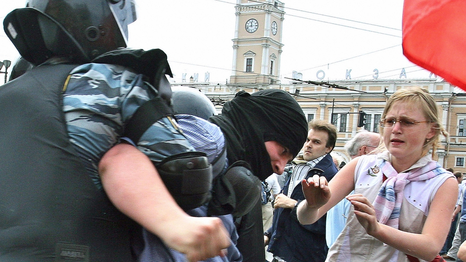 A protester is arrested by riot police ahead of the 2006 G8 summit in St Petersburg, Russia