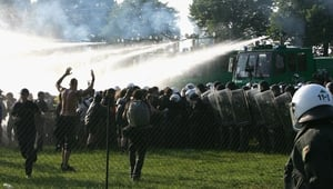 Police use water cannon to disperse protesters at Bollhagen, Germany during the summit at nearby Heiligendamm in 2007