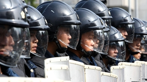 Japanese riot police stand guard during a protest march in Sapporo before the 2008 G8 summit