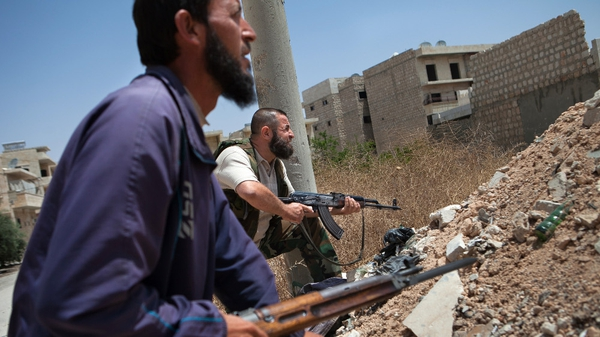 Syrian rebel fighters hold position in the northwestern town of Maaret al-Numan